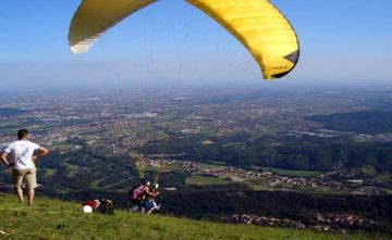 PARAGLIDE IN THE PICTURESQUE HILLS OF THE WESTERN GHATS AT K