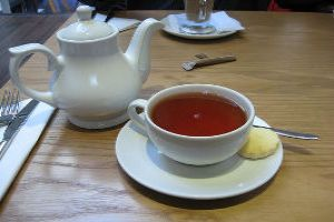 Sipping Cups Of Tea In Assam